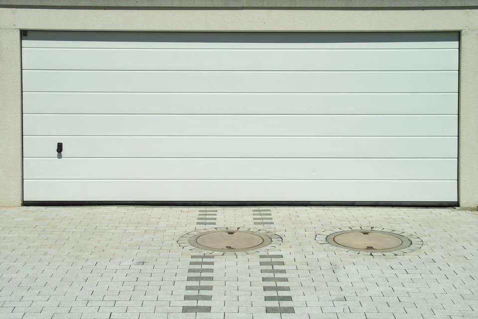 puesta en normativa de puertas de garaje t